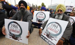 Sikh minority representatives sit in front the European headquarters of the United Nations in Geneva November 1, 2013. Earlier on Friday a delegation of representatives of several NGOs have submitted to the Office of the United Nations High Commissioner for Refugees (UNHCR) a petition urging to recognize the 1984 killing of Sikhs as 'Genocide'.  REUTERS/Denis Balibouse (SWITZERLAND - Tags: POLITICS CIVIL UNREST)
