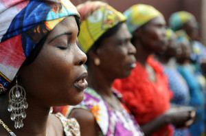 Congolese women sing for Belgium's King Albert II and Queen Paola visiting the King Baudouin hospital in Kinshasa July 1, 2010. Belgian King Albert II is ending a three-day official visit to Congo where he attended the celebrations of the 50th anniversary of its independence. REUTERS/Frederic Sierakowski/Pool (DEMOCRATIC REPUBLIC OF CONGO - Tags: POLITICS) - RTR2FZQK