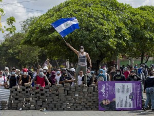 People demonstrate near a cobblestone barricade in Managua, Nicaragua, April 21. Pope Francis called for an end to violence in Nicaragua after several days of protests against proposed social security legislation led to the deaths of more than two dozen people. (CNS photo/Jorge Torres, EPA) See POPE-NICARAGUA-PROTESTS April 23, 2018.