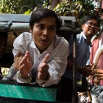 TOPSHOT - Detained Myanmar journalists Kyaw Soe Oo (C) and Wa Lone (R) talk to the media as is taken from a court in Yangon after making an appearance in his ongoing trial on February 14, 2018. The court earlier denied bail to Wa Lone and Kyaw Soe Oo, two Reuters journalists charged under a secrecy act that could see them face up to 14 years in jail, in a case that has sparked outcry over shrinking media freedom. / AFP PHOTO / YE AUNG THU        (Photo credit should read YE AUNG THU/AFP/Getty Images)